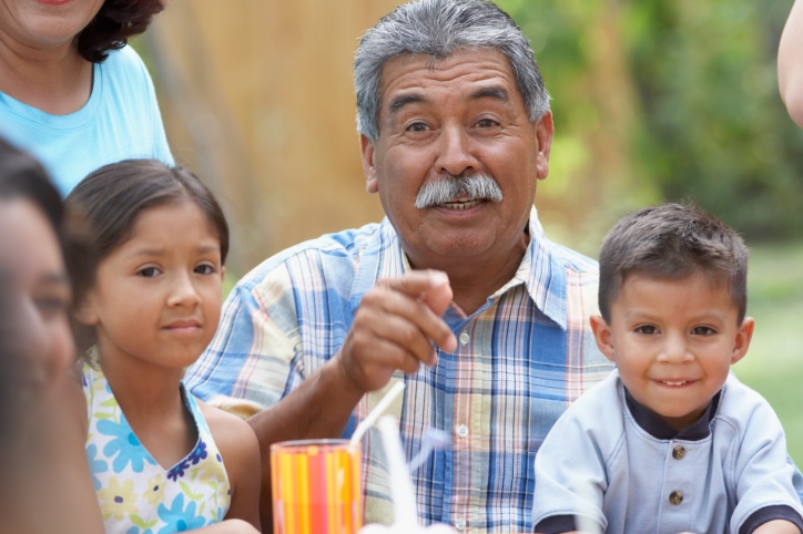 Portrait of a grandfather at a picnic with his grandchildren